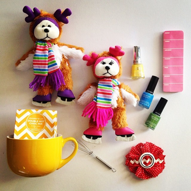 Some of my daughter's FAVOURITE GIFTS for the #7vignettes challenge. Two iceskating Beanie Kids, brightly coloured nail polish, a pink weekly notepad, a hot chocolate mug in her fave colour, and sachets with a cute mini whisk (from Officeworks) and a brooch that I made.